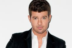 "Robin Thicke ""Reluctantly"" Sues Marvin Gaye's Family Over ""Blurred Lines"""
