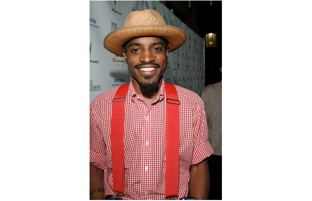 Andre in suspenders and a hat