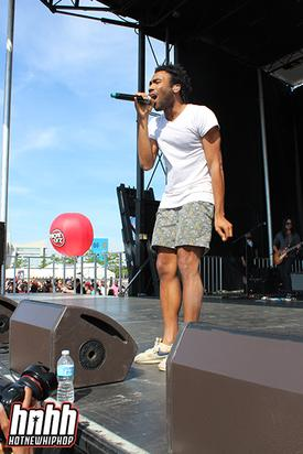 Childish Gambino rocks the stage in his usual outfit of above-the-knee shorts & and a white t