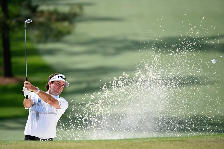 Bubba Watson of the United States plays a bunker shot on the seventh hole during the final round of the 2014 Masters Tournament at Augusta National Golf Club on April 13, 2014 in Augusta, Georgia. (Photo by Harry How/Getty Images)